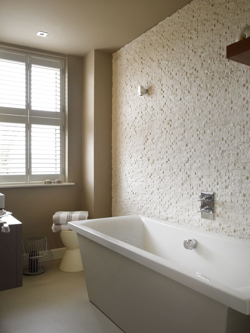 Portland stone tiled bathroom